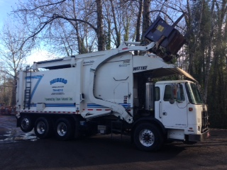 Heiberg Garbage truck emptying trash in neighborhood